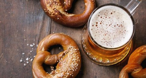 Pretzels and beer on wooden table