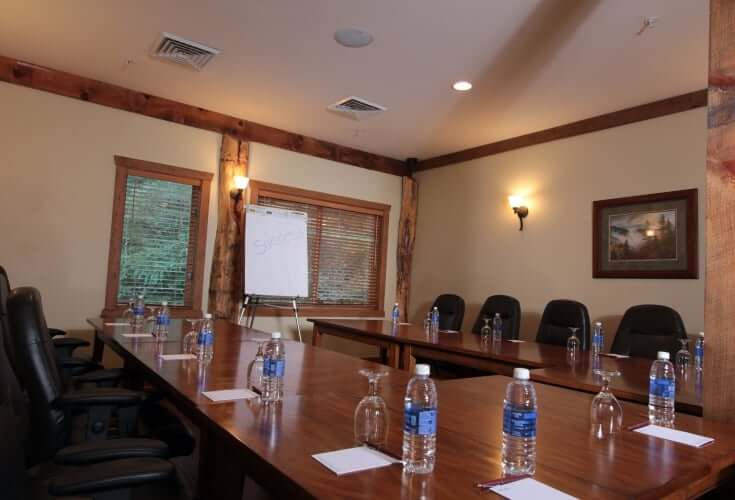 meeting room with water bottles on table