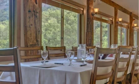 dining room with view of forest