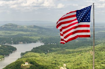 American flag at the top of Chimney Rock.
