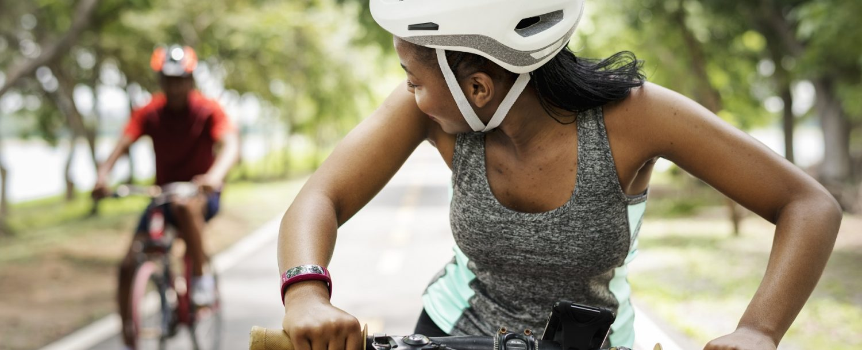 couple riding bikes thermal belt rail trail
